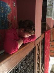 Christine peering down at the carpet showrooms